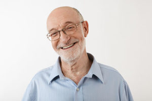 senior man smiling with clean home from senior living housekeeping services in boca raton fl