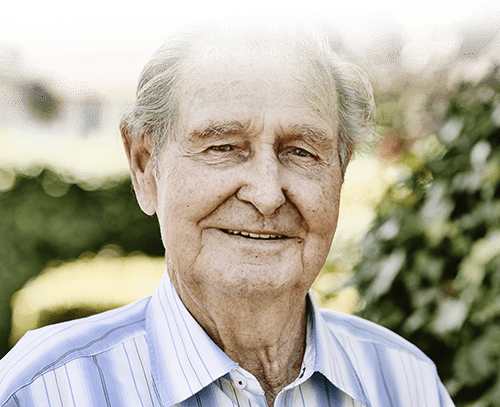 Elderly man with slight smile