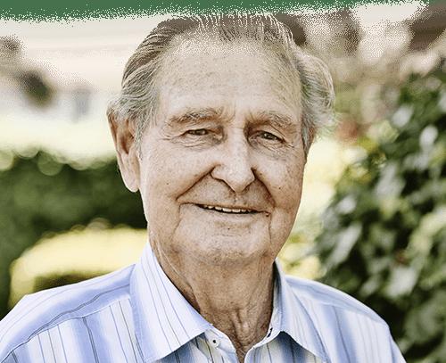 Elderly man with slight smile