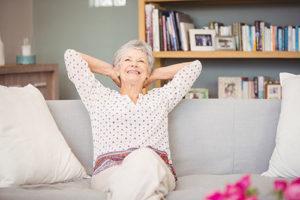 Happy senior woman sitting on a sofa